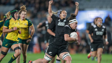 Charmaine McMenamin of New Zealand on her way to scoring a try against the Wallaroos.
