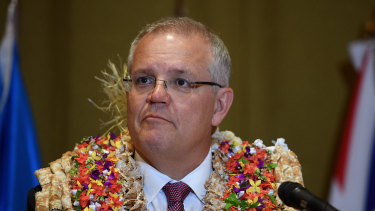 Prime Minister Scott Morrison, pictured in Fiji last year. Australia has kept all essential personnel in the South Pacific and its posts remain open.