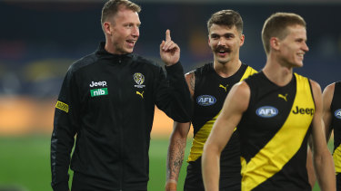 Dylan Grimes, left, injured a hamstring in the Tigers match against the Eagles.