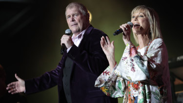 Olivia Newton-John joins John Farnham on stage.