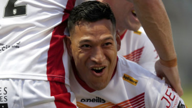 Folau celebrates his try after a lightning-fast start on debut.