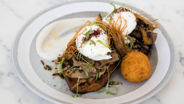 The seasonal mushrooms on toast come with dill rostis on the side.