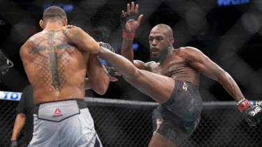 Full contact: Jon Jones, right, lands a kick on Thiago Santor during their UFC light heavyweight bout.
