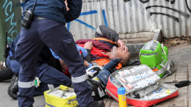 Paramedics attend to an overdose on Victoria Street in Richmond in 2019.
