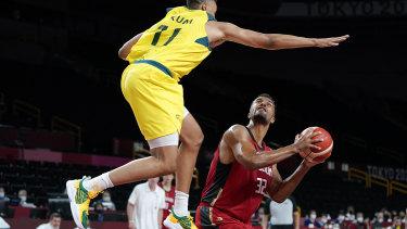 Australia's Dante Exum (11) tries to block a shot by Germany's Johannes Thiemann (32).