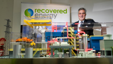 Recovered Energy Australia director Ian Guss with a model of the proposed waste to energy plant in Laverton North.