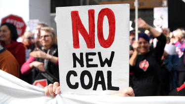 Adani-Adani protesters outside engineering construction company GHD in Brisbane on August 1. The Carmichael coal mine has become a lightning rod for the anti-coal movement.