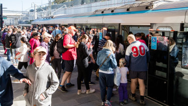 Passengers board the metro train at Tallawong Station on Sunday.