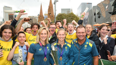 Ellyse Perry (left), with Meg Lanning and coach Matthew Mott, with the T20 World Cup trophy.