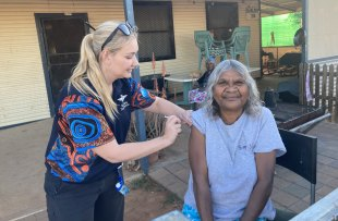 Cheryl Stewart receives her first dose of the Pfizer vaccine during a RFDS visit to the remote South Australian town of Oodnadatta.