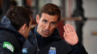 Helping hand: Andrew Johns talks tactics with Mitchell Pearce at Blues training.