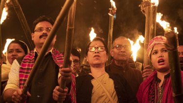 Indians participate in a torch light procession to protest against the Citizenship Amendment Bill (CAB) in Gauhati, India.