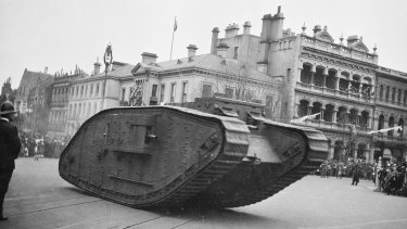 'The feelings of the crowd changed suddenly as the tank came into view. The grotesque war engine lurched and lumbered along the roadway – a grim terrifying machine.'