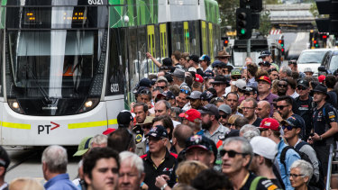 Big crowds catch trams to Albert Park for the grand prix each year.