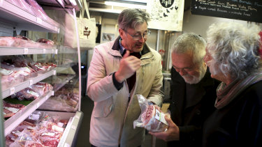 Butcher and Providore Grant Hilliard selling a lamb cut to his regular customers Cherry and Peter Best in his Marrickville retail store 'Feather and Bone'.