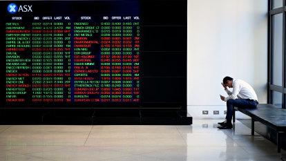 Stocks snap losing streak despite RBA cut weighing on banks