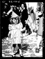 A little girl celebrates in Martin Place, Sydney on August 15, 1945.