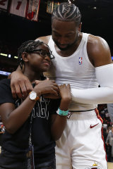 Dwyane Wade hugs Zion Wade after his final NBA game earlier this year.