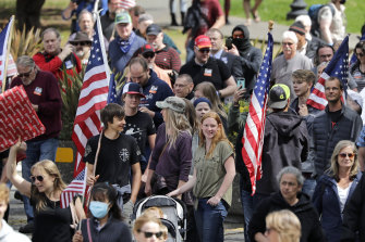 Demonstrators disregard social distancing guidelines as they crowd together at a protest in Olympia, Washington.