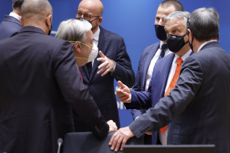 UN Secretary-General Antonio Guterres, partially seen left, and other leaders talk to Hungarian Prime Minister Viktor Orban, second right.