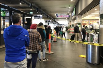 A long queue forms outside Woolworths supermarket in South Melbourne as customers prepare to stock up on shopping with Melbourne facing tougher stage four lockdown restrictions within days.