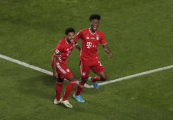 Kingsley Coman (right) celebrates with Serge Gnabry.