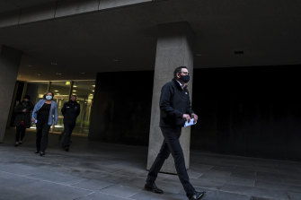 Victorian Premier Daniel Andrews walks into his COVID-19 update on Saturday.