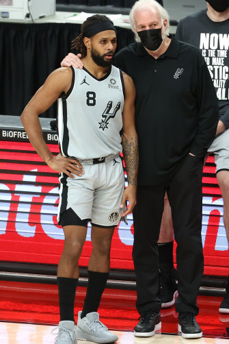 Mills with Gregg Popovich at an NBA game earlier this year. The San Antonio Spurs coach once talked about Eddie Mabo to inspire his players.