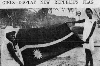 Nauruan's Rosavine Jose, 16, and Margaret Jose, 21, displays the flag of the new independent Republic of Nauru during independence ceremonies 31st January 1968.