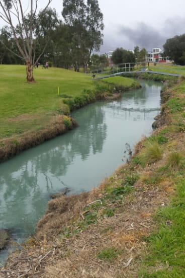 Stony Creek, at the Spotswood Golf Course, turned an unusual color as water from the firefighting efforts at the West Footscray factory blaze ran into it on Friday.