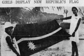 Nauruan's Rosavine Jose, 16, and Margaret Jose, 21, displays the flag of the new independent Republic of Nauru during independence ceremonies 31st January 1968.