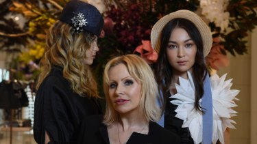 Milliner Nerida Winter (centre) with two models showing the trends for the season, which include oversized brims.