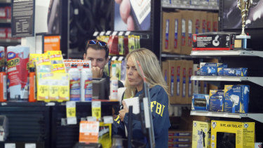 An FBI agent interviews staff at an Auto Zone auto parts store in Florida as part of their investigations into Cesar Sayec jnr.