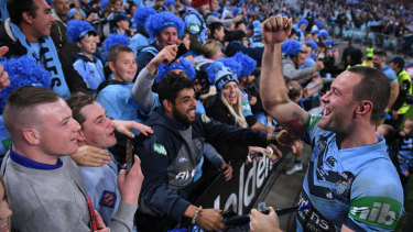 Priceless: Blues captain Boyd Cordner celebrates victory in last year's Origin series.