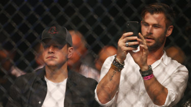 Star power: Hollywood heavyweights Matt Damon and Chris Hemsworth watch the fight.