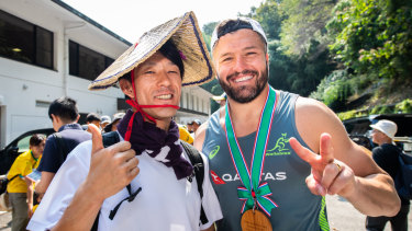 Peace: Ashley-Cooper mingles with a fan in Odawara.