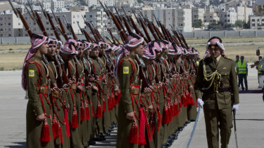 A Jordanian army officer inspects the honour guard in preparation for the arrival of Prince William.