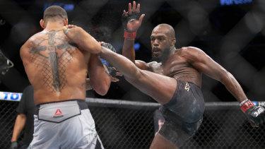Full contact: Jon Jones, right, lands a kick on Thiago Santor during their UFC light heavyweight bout.