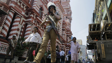 A Sri Lankan police officer patrols outside a mosque in Colombo on Wednesday.