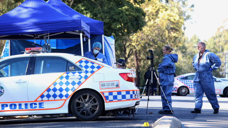 Forensic officers examine the crime scene on Blyth Road in Murrumba Downs.