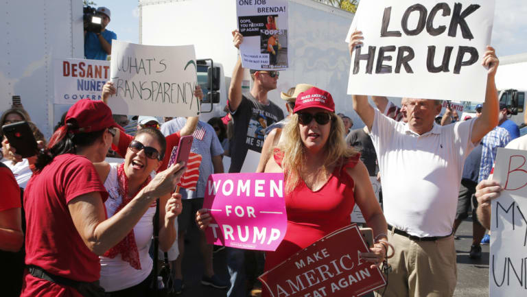 A crowd protests outside the Broward County Supervisor of Elections office on Friday over the midterm count.