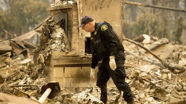 Alameda County Sheriff's deputy A. Gogna searches for victims of the Camp Fire.