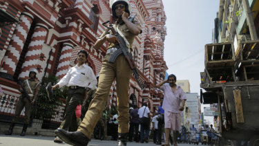 A Sri Lankan police officer patrols outside the same mosque last week in the wake of the Easter Sunday attacks.