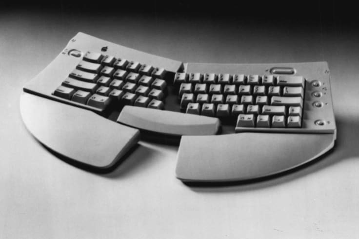 Apple's Adjustable Keyboard, 1993.  Such keyboards are said to make typing more comfortable, but the company stopped short of claiming they would help in cases of repetitive strain injury.
