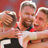 In-form trio of Stringer, Parish, and Merrett lead the Bombers home over Roos