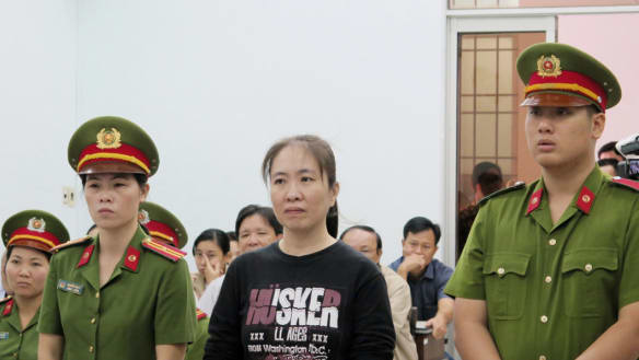 Vietnam frees Mother Mushroom blogger on condition she leave for US