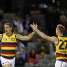 Taylor Walker celebrates a goal with team mate Tom Lynch during the Crows' clash with North Melbourne.