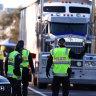 Queensland Police stop trucks at the Queensland border on August 25, 2021 in Coolangatta, Australia.