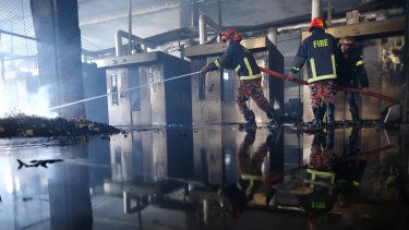 Firefighters work to douse a fire at a food and beverage factory in Rupganj, outside Dhaka, Bangladesh.