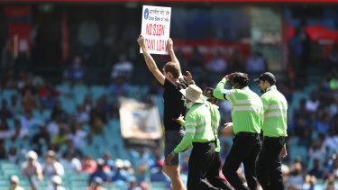 A protester walks onto the pitch during play during game one of the One Day International series between Australia and India at Sydney Cricket Ground on November 27, 2020 in Sydney.